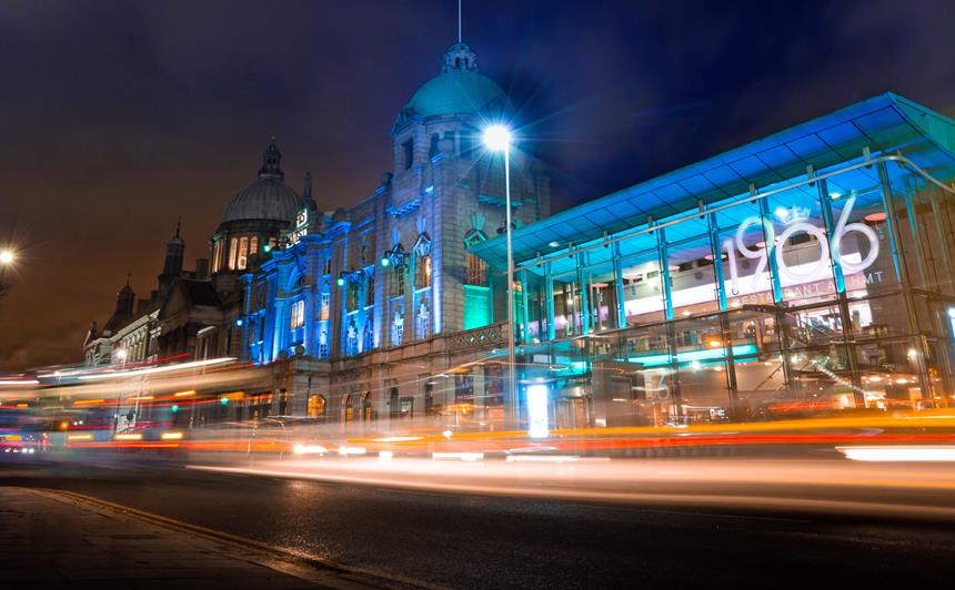 His Majesty's Theatre in Aberdeen illuminated at night time with lights from traffic streaming past