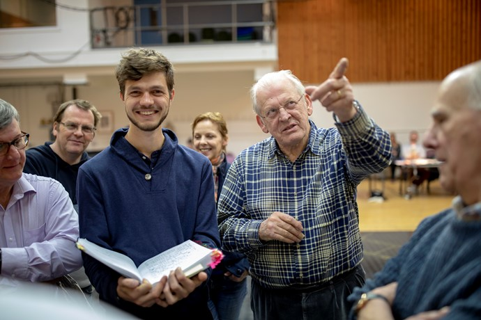 Assistant Director Peter Lorenz, Director Sir Thomas Allen and The Chorus of The Magic Flute in rehearsals. Scottish Opera 2019. Credit James Glossop (1).JPG